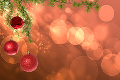 Christmas red balls with green fir tree on pink red bokeh  Stock Images