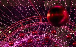 Christmas red balls hang on the construction. Royalty Free Stock Images