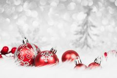 Christmas red balls with silver decoration on the snow. Xmas card Stock Image