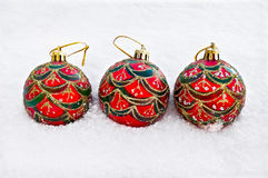 Christmas red balls in the snow Stock Photos