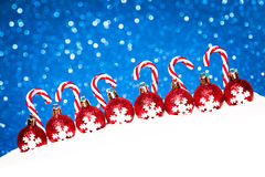 Christmas red balls in snow on blue glitter Stock Photography