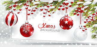 Christmas red balls with snow covered fir branches Royalty Free Stock Photography