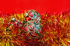 Christmas red balls with tinsel. Three red Christmas ball with a pattern in red and gold tinsel on red background Stock Photography
