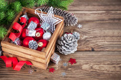 Christmas red balls in wooden box Stock Photos