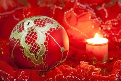 Christmas red bauble and candle Royalty Free Stock Photos