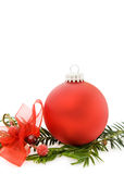 Christmas red bauble and evergreen branch Royalty Free Stock Photos