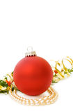 Christmas red bauble and pearls. Celebrating Christmas with red bauble, pearls and pine tree branch. Isolated on white background with room for your text stock images