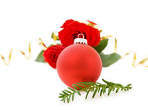 Christmas red bauble and roses Stock Images