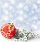Christmas red bauble and snow tree. Christmas branch of tree red bauble against snow background Stock Images