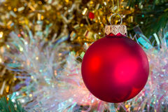 Christmas red bauble with sparkly tinsel Stock Images