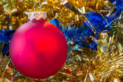 Christmas red bauble with tinsel Royalty Free Stock Photos