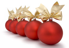 Christmas red baubles. With ornamental ribbon (bow) arranged abreast on white background. Clipping path incl Royalty Free Stock Images