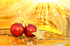 Christmas red baubles on the yellow background Stock Photos