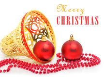 Christmas red baubles, yellow bell and beads Royalty Free Stock Photo