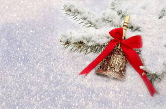 Christmas Red Bell lie in the snow Royalty Free Stock Photos
