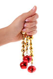Christmas red bells in hand isolated on white Royalty Free Stock Photography