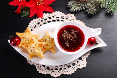 Christmas red borscht with puff pastries Stock Image