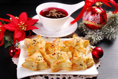 Christmas red borscht with puff pastries Royalty Free Stock Photos