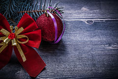 Christmas red bow bauble evergreen pine branch holidays concept Stock Images