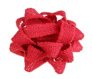 Christmas red bow made of coarse jute fabric isolated stock photo
