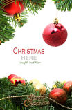 Christmas red bubbles and Spruce Tree Stock Image