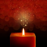 Christmas red candle. Christmas burning magic red candle royalty free stock photo
