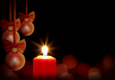 Christmas red candle and baubles Royalty Free Stock Images