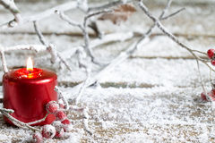 Christmas red candle and branches in snow Royalty Free Stock Photography
