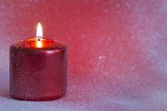 Christmas red candle closeup background Stock Image