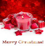 Christmas red candle with snow Stock Photo