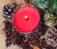 Christmas red candle and spice Royalty Free Stock Photo