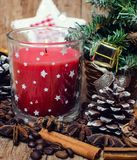 Christmas red candle and spice Stock Images