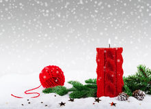 Christmas red candle and spruce branch Royalty Free Stock Photos