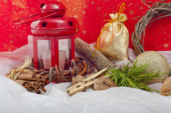 Christmas red candle with stars and cinnamon on a red Stock Photos