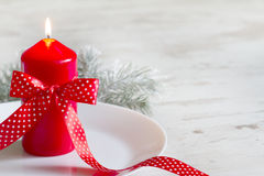 Christmas red candle on the table abstract background Royalty Free Stock Image