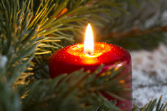 Christmas red candle wit fir closeup. Concept royalty free stock image