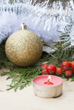 Christmas red candle on wooden table among Christmas and New Year ball and decor Royalty Free Stock Photography