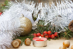 Christmas red candle on wooden table among Christmas and New Year ball and decor Stock Photography