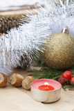 Christmas red candle on wooden table among Christmas and New Year ball and decor Stock Photos