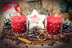 Christmas red candles and spice Stock Photography