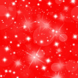 Christmas red card with bright stars and snowflakes Royalty Free Stock Photography