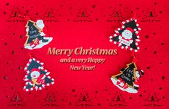 Christmas Red Card with Greetings Text, and Decorations Trees, Santa and Snowmen royalty free stock photo