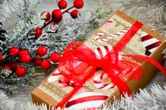 Christmas. Red Christmas flower packed gift and snow fir tree. on traditional white wood background Royalty Free Stock Images