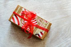 Christmas. Red Christmas  gift box  on traditional white wood background Royalty Free Stock Images