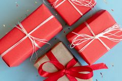 Christmas red and craft gift boxes with white and red ribbons royalty free stock photo