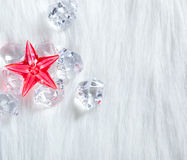 Christmas red crystal star on ice cubes and fur Royalty Free Stock Image