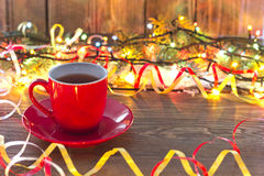 Christmas red cup. Christmas garlands of red cup on the table Stock Image