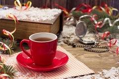 Christmas red cup. Christmas garlands of red cup on the table Stock Photos
