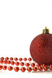 Christmas. Red Decoration - ball and tinsel Royalty Free Stock Image
