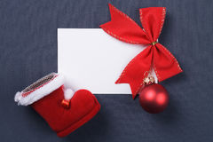 Christmas red decoration over grey Royalty Free Stock Photos